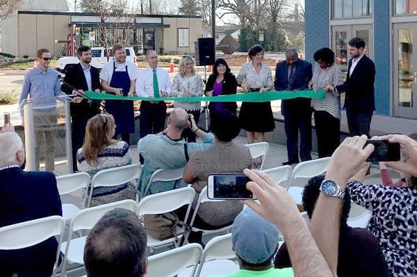 Photo of citizens and city officials cutting the ribbon at West Greenville Plaza