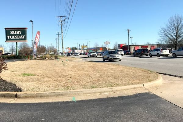 Photo of Woodruff Road showing the lack of existing sidewalks